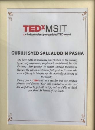 12 Syed Sallauddin Pasha receiving receiving from TEDX